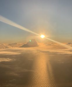 Cloud and sun from airplane window