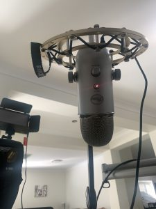 Blue Yeti mic hanging from a shock mount and arm