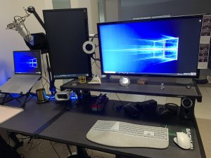 Desk at home with two monitors